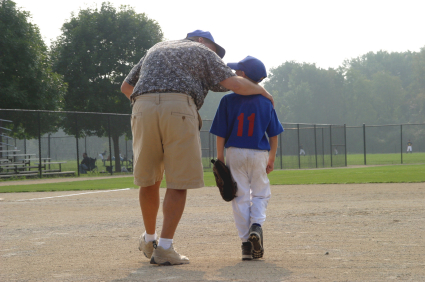 Image of Youth Baseball player and parent